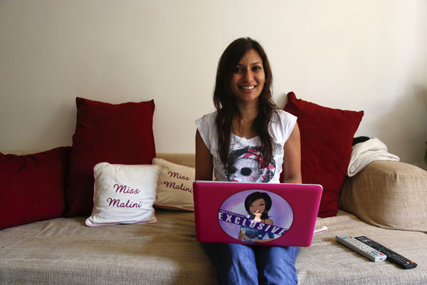 Malini Agarwal poses for a picture as she blogs from her living room in Mumbai